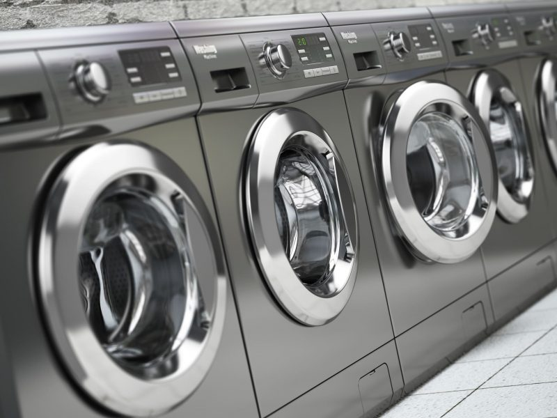 row-of-washing-machines-in-a-public-laundromat-P6M5UWA (1) (1)