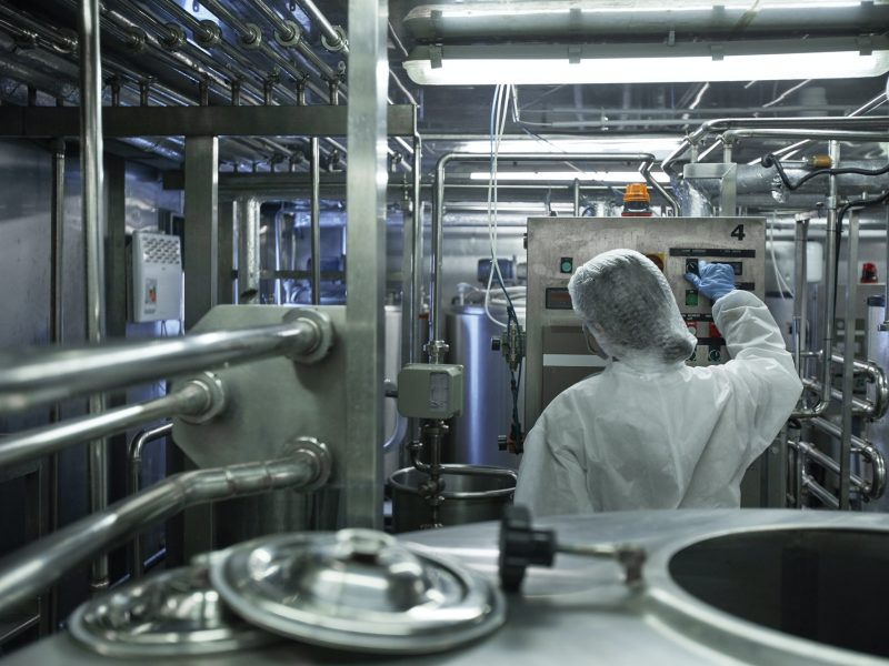 Worker Controlling Production at Factory